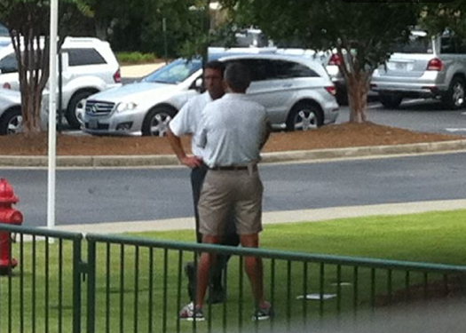 Tiger Woods' agent, Mark Steinberg, chats with Woods' former caddie, Steve Williams, on Tuesday at Atlanta Athletic Club.