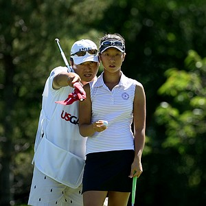 Cindy Ha with her caddie during the Round of 32. Ha defeated Jaye Marie Green to advance.