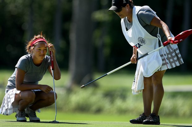 Annie Park and her caddie/mother, Young Park, during the Round of 16. Park lost to Erynne Lee.