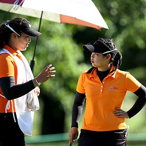 Moriya Jutanugarn, right, and her sister, Ariya, acting as caddie during the Round of 16. Moriya will play Casey Danielson in the Quarterfinals.