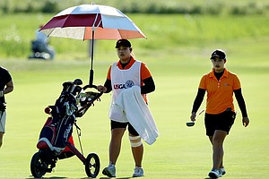Ariya Jutanugarn acted as caddie for her sister Moriya Jutanugarn during the Round of 16 at the U. S. Women's Amateur Championship. Ariya lost to Lindy Duncan but helped her sister defeat Victoria Tanco.