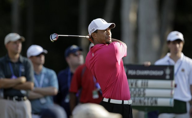Tiger Woods hits a shot on the 11th hole during the first round of the PGA Championship golf tournament Thursday, Aug. 11, 2011, at the Atlanta Athletic Club in Johns Creek, Ga.
