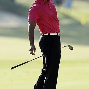 Tiger Woods reacts after a shot on the 11th hole during the first round of the PGA Championship golf tournament Thursday, Aug. 11, 2011, at the Atlanta Athletic Club in Johns Creek, Ga.
