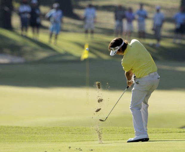 Bubba Watson hits a shot on the 11th hole during the first round of the PGA Championship golf tournament Thursday, Aug. 11, 2011, at the Atlanta Athletic Club in Johns Creek, Ga.