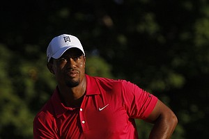 Tiger Woods hits a drive on the 10th hole during the first round of the PGA Championship golf tournament Thursday, Aug. 11, 2011, at the Atlanta Athletic Club in Johns Creek, Ga.