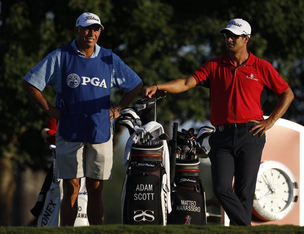 Adam Scott, of Australia, and caddie Steve Williams before a drive on the 10th hole during the first round of the PGA Championship golf tournament Thursday, Aug. 11, 2011, at the Atlanta Athletic Club in Johns Creek, Ga.