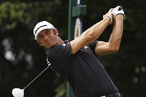Dustin Johnson hits a drive on the 10th hole during the first round of the PGA Championship golf tournament Thursday, Aug. 11, 2011, at the Atlanta Athletic Club in Johns Creek, Ga.