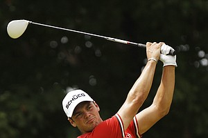 Martin Kaymer, of Germany, hits a drive on the 10th hole during the first round of the PGA Championship golf tournament Thursday, Aug. 11, 2011, at the Atlanta Athletic Club in Johns Creek, Ga.