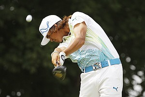Rickie Fowler hits a drive on the 10th hole during the first round of the PGA Championship golf tournament Thursday, Aug. 11, 2011, at the Atlanta Athletic Club in Johns Creek, Ga.