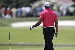 Tiger Woods flips his club after hitting out of a bunker on the sixth hole during the first round of the PGA Championship golf tournament Thursday, Aug. 11, 2011, at the Atlanta Athletic Club in Johns Creek, Ga. Woods had double bogey the hole.