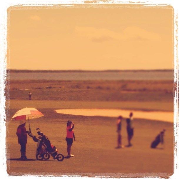 Moriya Jutanugarn and her mom/caddie at No. 15 with the Narragansett Bay in the background.