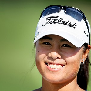 Defending champion, Danielle Kang is all smiles after winning her match during the Quarterfinals.