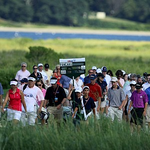 Players Erynne Lee and Brooke Pancake along with spectators, officials and media head down the 18th fairway with the match all square during the Quarterfinals. Pancake won on the 21st hole.