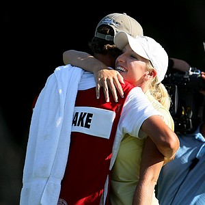 Brooke Pancake hugs her caddie, Matt Marra, after defeating Erynne Lee in 21-holes during the Quarterfinals.