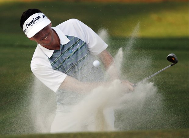 Keegan Bradley hits out of a bunker on the ninth hole during the second round of the PGA Championship golf tournament Friday, Aug. 12, 2011, at the Atlanta Athletic Club in Johns Creek, Ga.