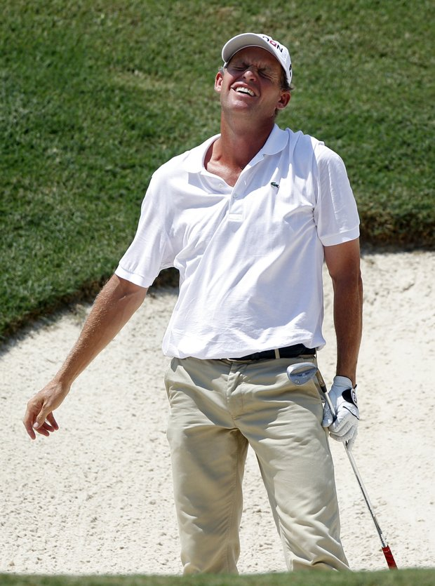 Anders Hansen, of Denmark, reacts to a bunker shot on the 18th hole during the second round of the PGA Championship golf tournament Friday, Aug. 12, 2011, at the Atlanta Athletic Club in Johns Creek, Ga.