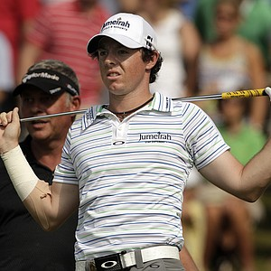 Rory McIlroy, of Northern Ireland, watches his drive on the 15th hole with Darren Clarke, of Northern Ireland,during the second round of the PGA Championship golf tournament Friday, Aug. 12, 2011, at the Atlanta Athletic Club in Johns Creek, Ga.