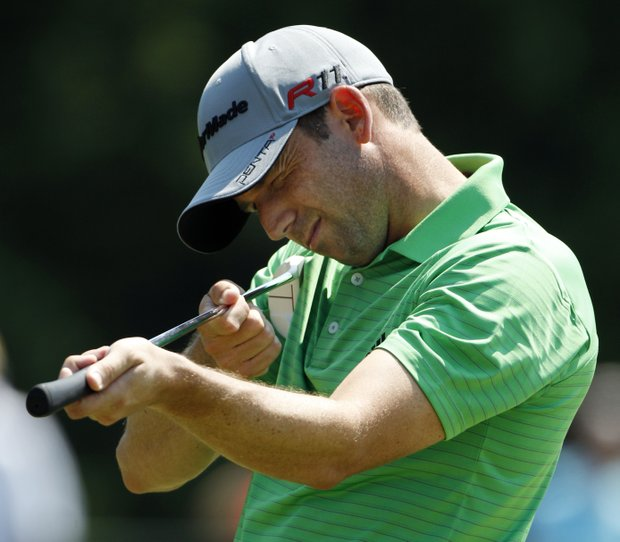 Sergio Garcia, of Spain, takes aim after his ball stopped on the lip of the cup on the fifth hole during the second round of the PGA Championship golf tournament Friday, Aug. 12, 2011, at the Atlanta Athletic Club in Johns Creek, Ga.