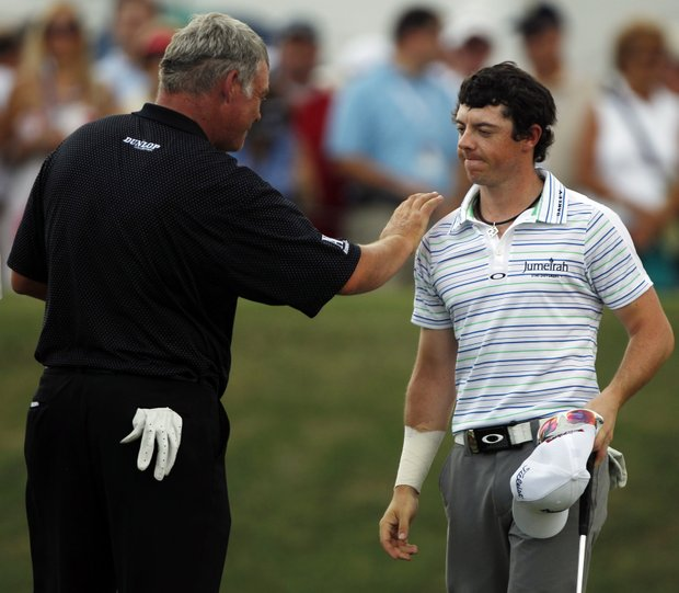 Darren Clarke, of Northern Ireland, congratulates Rory McIlroy, of Northern Ireland, after they finished their the second round of the PGA Championship golf tournament Friday, Aug. 12, 2011, at the Atlanta Athletic Club in Johns Creek, Ga.