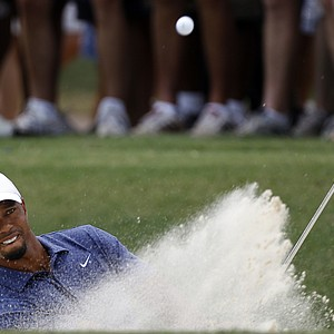 Tiger Woods hits out of a bunker on the first hole during the second round of the PGA Championship golf tournament Friday, Aug. 12, 2011, at the Atlanta Athletic Club in Johns Creek, Ga.