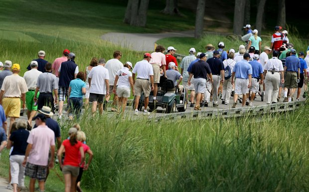Spectators and golfers make their way across the bridge at No. 7 during the semifinals at the U. S. Women's Amateur Championship at Rhode Island Country Club in Barrington, Rhode Island.