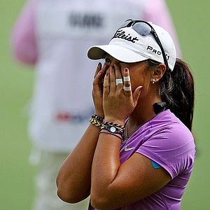 All covered in tape, Danielle Kang reacts to winning during the semifinals at the U. S. Women's Amateur Championship at Rhode Island Country Club in Barrington, Rhode Island.