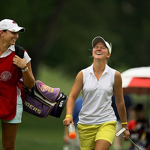 Austin Ernst and her caddie Emily Tubert share a laugh walking up No. 13 during the semifinals at the U. S. Women's Amateur Championship at Rhode Island Country Club in Barrington, Rhode Island.