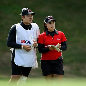 Moriya Jutanugarn, right, and her sister, Ariya during the semifinals at the U. S. Women's Amateur Championship at Rhode Island Country Club in Barrington, Rhode Island.