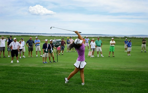 Danielle Kang hits her second shot at No. 18 during the semifinals at the U. S. Women's Amateur Championship at Rhode Island Country Club in Barrington, Rhode Island.