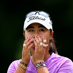 Danielle Kang reacts after her match with all her taped fingers during the semifinals at the U. S. Women's Amateur Championship at Rhode Island Country Club in Barrington, Rhode Island.