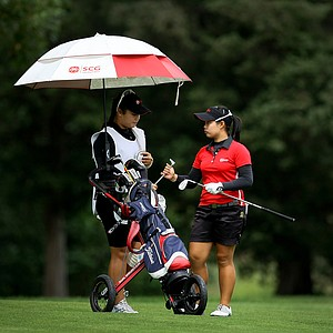 Moriya Jutanugarn, right, with her sister, Ariya, acting as caddie during the semifinals at the U. S. Women's Amateur Championship at Rhode Island Country Club in Barrington, Rhode Island.