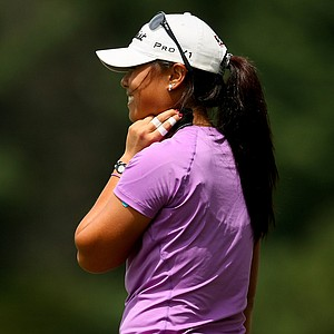 Danielle Kang tries to push down the taping on her neck during the semifinals at the U. S. Women's Amateur Championship at Rhode Island Country Club in Barrington, Rhode Island.