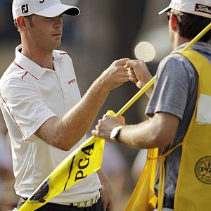 Brendan Steele, left, celebrates with caddie Nick Wilkins after making a birdie on the 14th hole during the third round of the PGA Championship golf tournament Saturday, Aug. 13, 2011, at the Atlanta Athletic Club in Johns Creek, Ga.