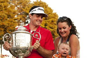 Keegan Bradley of the U.S. with his nephew Aiden and sister Madison as he receives the Wanamaker trophy after his playoff victory over Jason Dufner in the final round of the 2011 PGA Championship Tournament at Atlanta Athletic Club August 14, 2011 in Johns Creek, Georgia.
