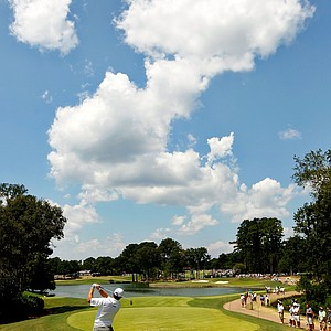 Lee Westwood of England hits his tee shot on the fourth hole during the final round of the 93rd PGA Championship at the Atlanta Athletic Club on August 14, 2011 in Johns Creek, Georgia.