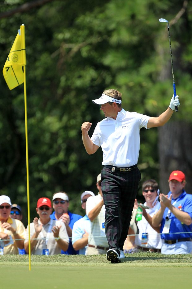 Luke Donald of England reacts to a birdie chip on the third hole during the final round of the 93rd PGA Championship at the Atlanta Athletic Club on August 14, 2011 in Johns Creek, Georgia.