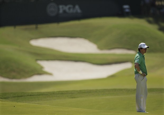 Rory McIlroy, of Northern Ireland, waits to hit on the 11th hole during the final round of the PGA Championship golf tournament Sunday, Aug. 14, 2011, at the Atlanta Athletic Club in Johns Creek, Ga.