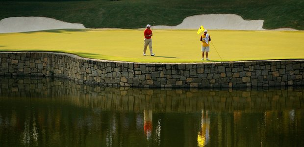 Lee Westwood of England and his caddie Billy Foster are seen on the 17th hole during the third round of the 93rd PGA Championship at the Atlanta Athletic Club on August 13, 2011 in Johns Creek, Georgia.