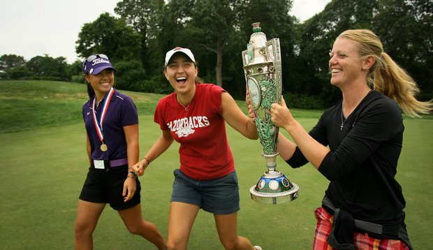 Friends and fellow players, Amy Anderson, right, and Emily Tubert, center, joke around with the trophy after Danielle Kang posed for pictures during the final round at the U. S. Women's Amateur Championship at Rhode Island Country Club in Barrington, Rhode Island.