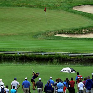 Danielle Kang hits her second shot at No. 4 where she made birdie in the morning and par in the afternoon during the final round at the U. S. Women's Amateur Championship at Rhode Island Country Club in Barrington, Rhode Island.
