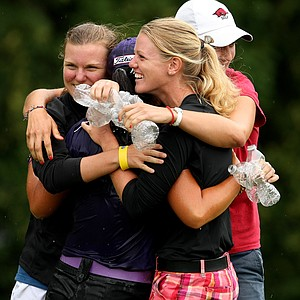 Danielle Kang is congratulated by her friends and fellow players, Austin Ernst, left, Emily Tubert, center, and Amy Anderson, far right, after winning the 2011 U. S. Women's Amateur Championship at Rhode Island Country Club in Barrington, Rhode Island.