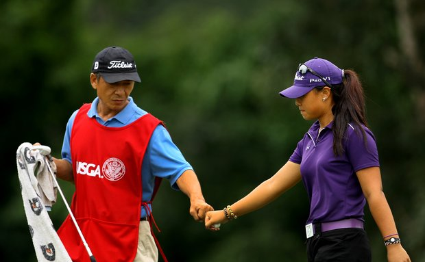 Danielle Kang and her father/caddie, K. S. Kang bump fists at No. 12, where she birdied and went 5-up during the final round at the U. S. Women's Amateur Championship at Rhode Island Country Club in Barrington, Rhode Island.