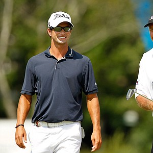 Adam Scott of Australia and caddie Steve Williams share a laugh during the final round of the 93rd PGA Championship at the Atlanta Athletic Club on August 14, 2011 in Johns Creek, Georgia.
