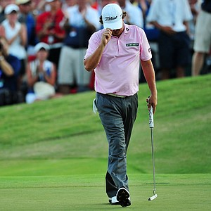 Jason Dufner waves to the gallery on the third playoff hole during the final round of the 93rd PGA Championship at the Atlanta Athletic Club on August 14, 2011 in Johns Creek, Georgia.