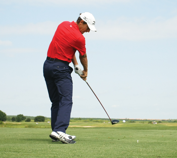 Howell wants the club to move left of the target line immediately after impact, which helps produce a fade. Before, Howell's clubhead would go to the right of the target line immediately after impact, which led to a draw.