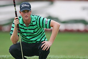 Webb Simpson lines up his birdie putt on the 18th hole during the final round of The Greenbrier Classic.