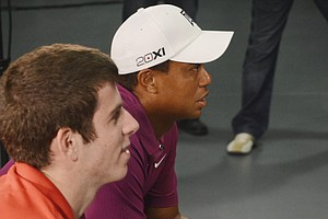 "3 p.m.: Golfweek was granted exclusive access to an EA Sports motion-capture session with Tiger Woods on Tuesday in Orlando, Fla. During the day, Tiger was taken through different stations where everything from headshots, to voiceovers, to a breakdown of the upcoming features in the Tiger Woods PGA Tour 2013 game (slated for release next Spring) and finally to the actual capturing of his swings. Above, Tiger spent about 30 minutes playing the game with contest winner, Kevin O'Connor. Tiger played as himself, while O'Connor chose to be Rickie Fowler. O'Connor beat Tiger handily, as the 19-year-old Indiana University student told Tiger, ""I have more time to practice than you do."" Tiger quipped in return, ""Not this weekend."" O'Connor razzed Tiger throughout the process, which was met with laughter from Tiger. On Monday (Aug. 22, 2011), we will be releasing an exclusive video that will kick off a year-long series on the making of the new game."