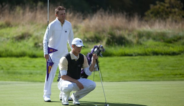 Garrett Clegg (left) helps Nick Taylor read a putt.