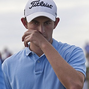 Patrick Cantlay, of Los Alamitos, Calif., reacts as he walks off the green on the 17th hole during the final round at the U.S. Amateur golf tournament Sunday, Aug. 28, 2011, at Erin Hills in Erin, Wis.
