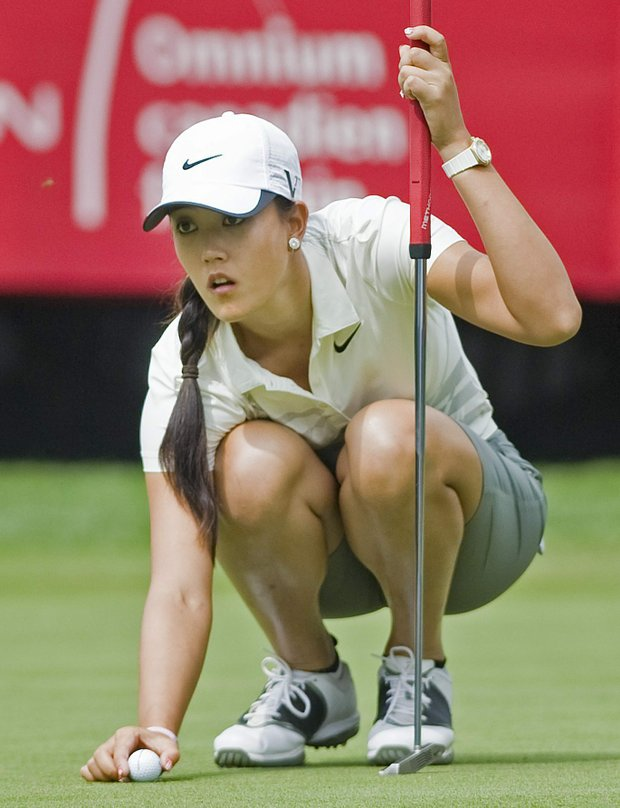 Michelle Wie from the United States lines up a putt on the 18th green at the Canadian Women's Open golf tournament at the Hillsdale Golf Club in Mirabel, Quebec, Thursday, Aug. 25, 2011.